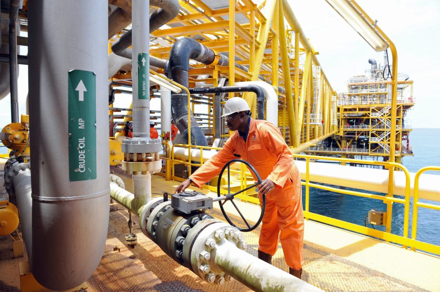 A worker inspect facilities on an upstream oil drilling platform at the Total oil platform at Amenem, 35 kilometers away from Port Harcourt in the Niger Delta. Amenem is the hub of Total oil production with two oil well producing over 100,000 barrels of crude daily. AFP PHOTO / PIUS UTOMI EKPEI (Photo credit should read PIUS UTOMI EKPEI/AFP/Getty Images)