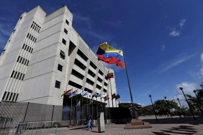 FILE PHOTO - A man walks in front of a building of the Venezuela Supreme Court in Caracas December 23, 2015. REUTERS/Carlos Garcia Rawlins/File Photo