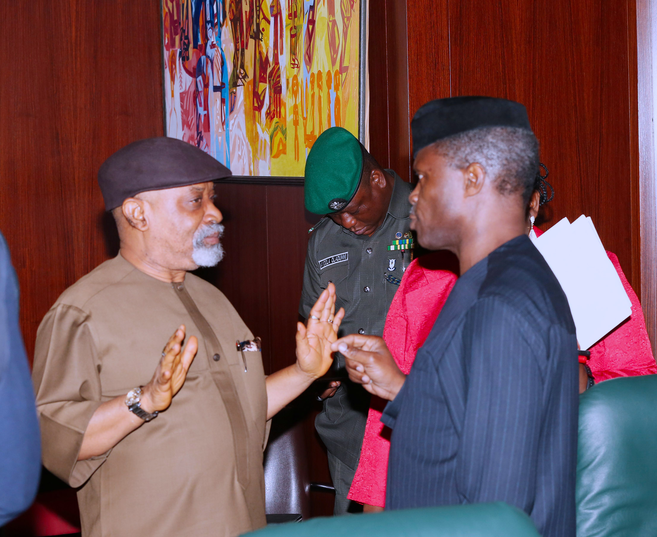AG PRESIDENT OSINBAJO PRESIDES OVER FEC MEETING 5. R-L; Acting President Yemi Osinbajo chats with Minister of Labour and Employment Sen Chris Ngige shortly after the FEC Meeting at the Council Chambers, State House Abuja. PHOTO; SUNDAY AGHAEZE./STATE HOUSE IN ABUJA. JULY 19 2017