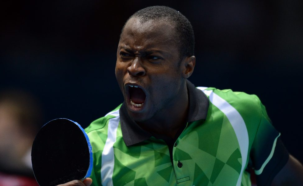 Quadri Aruna of Nigeria shouts after defeating Carlos Machado of Spain during a table tennis men's single preliminary round match of the London 2012 Olympic Games at the Excel centre in London on July 28, 2012. AFP Photo / Saeed Khan (Photo credit should read SAEED KHAN/AFP/GettyImages)