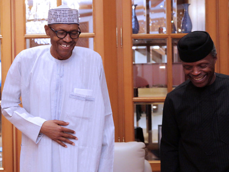 Nigerian President Muhammadu Buhari (L) smiles next to his deputy Yemi Osibanjo in Abuja, Nigeria, May 7, 2017. Bayo Omoboriowo/Presidential office/Handout via Reuters ATTENTION EDITORS - FOR EDITORIAL USE ONLY. NO RESALES. NO ARCHIVES. THIS IMAGE HAS BEEN SUPPLIED BY A THIRD PARTY. - RTS15KQL