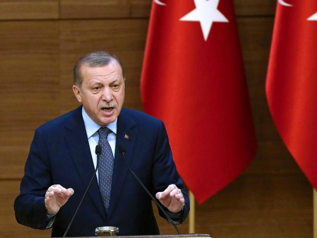 'No mercy for traitors' as Turkey President Threatens to 'Chop Off the Heads' of Critics