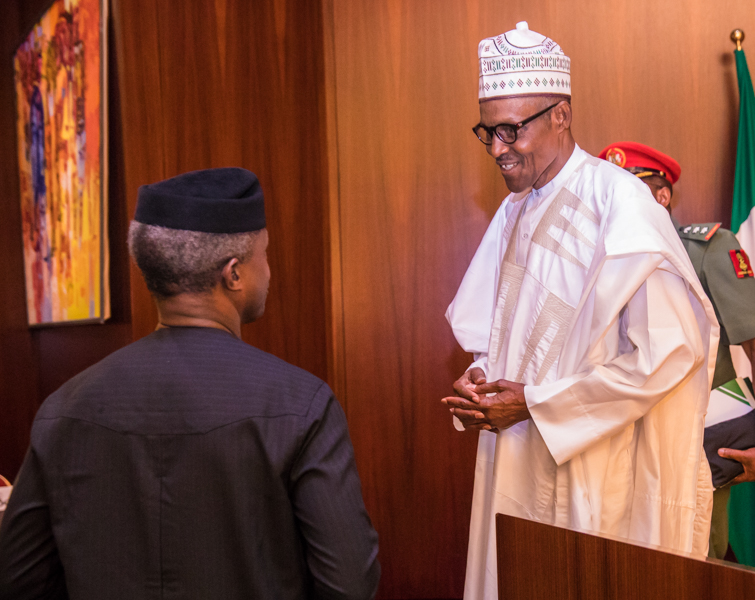 13 pictures of amazing bromance between President Buhari and Vice Osinbajo