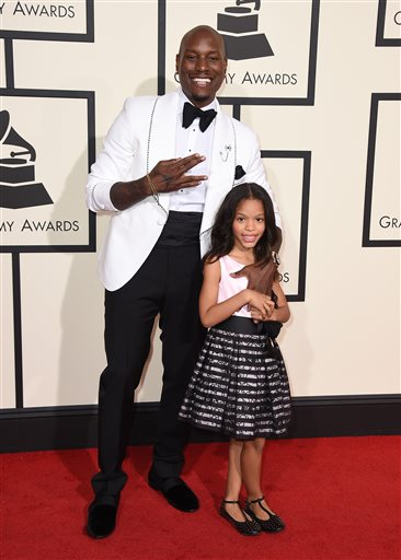 Tyrese Gibson, left, and Shayla Gibson arrive at the 58th annual Grammy Awards at the Staples Center on Monday, Feb. 15, 2016, in Los Angeles. (Photo by Jordan Strauss/Invision/AP)