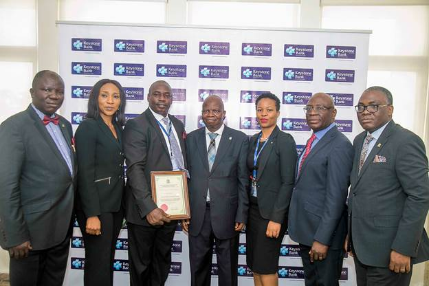 The Day in Pictures: CIBN accredits Keystone Bank Training Academy