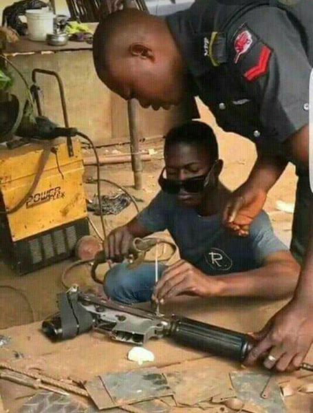 The Day in Pictures: Welder fixes Nigeria Police Rifle