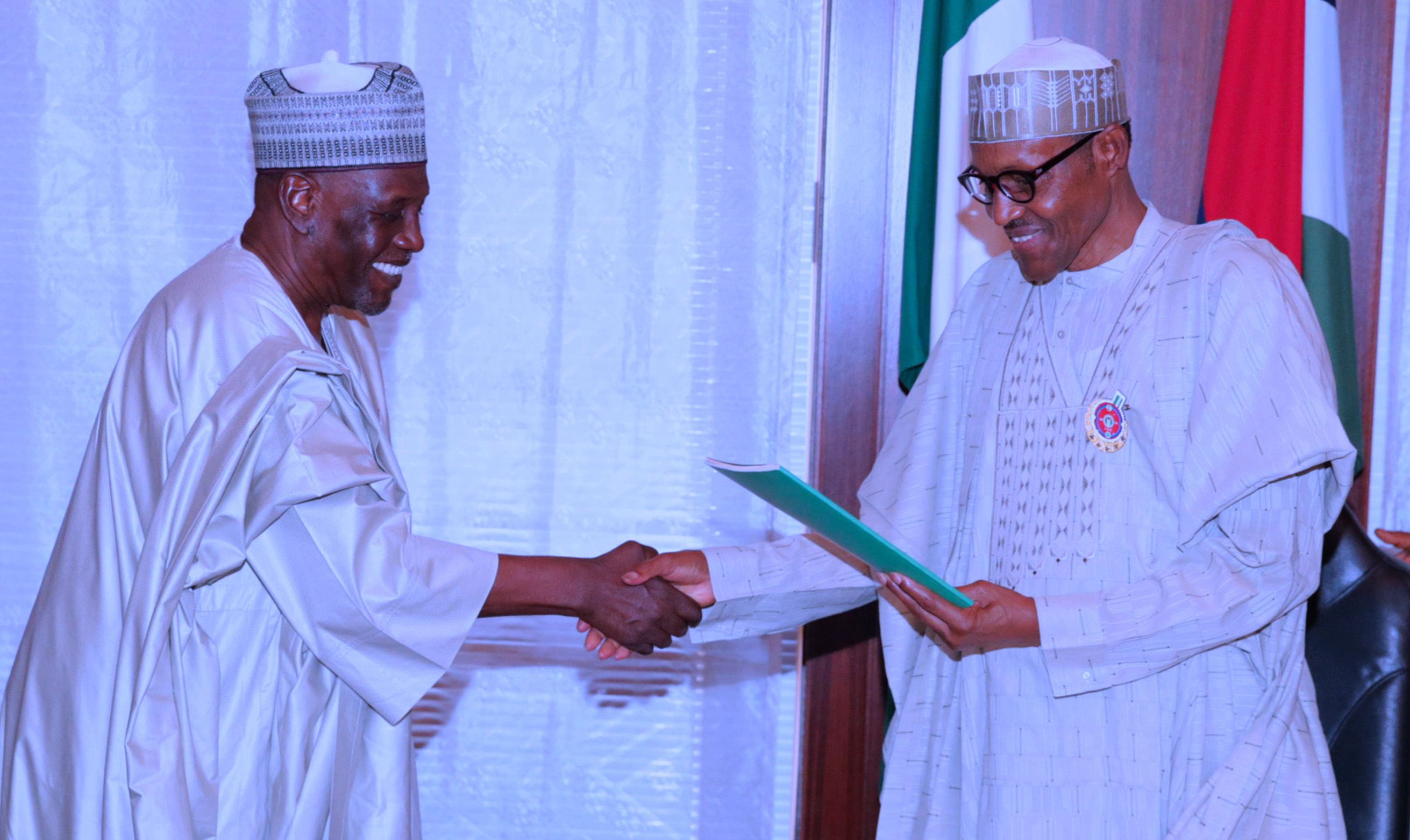 PRESIDENT BUHARI RECEIVES PANEL REPORT ON NIA 1B. President Muhammadu Buhari receives the panel report from the Chairman of the Panel, Ambassador Babagana Kingibe during the presentation of report of the Presidential Review panel on National Intelligence Agency (NIA) at the State House in Abuja. PHOTO; SUNDAY AGHAEZE. DEC 19 2017