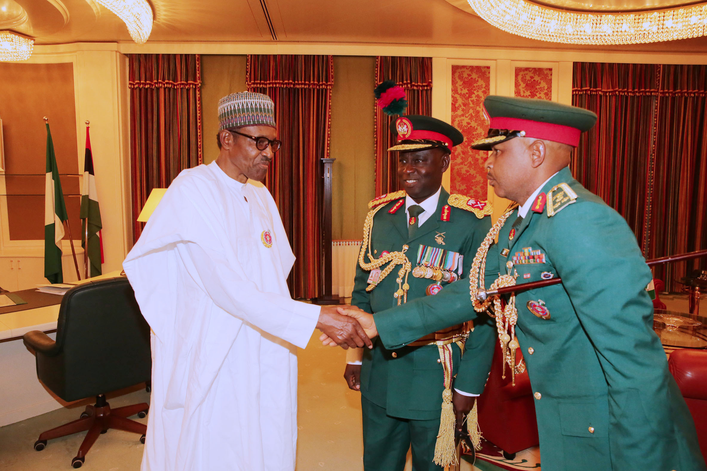 PRESIDENT BUHARI RECEIVES INCOMING AND OUTGOING COMM GUARDS BRIGADE 2. President Muhammadu Buhari receives the The Incoming Commander, Guards Brigade, Brig Gen Umar Thomas Musa (Right) and the Out-Going Commander Guards Brigade, Major General MS Yusuf at the State House in Abuja. PHOTO; SUNDAY AGHAEZE. JAN 16 2018