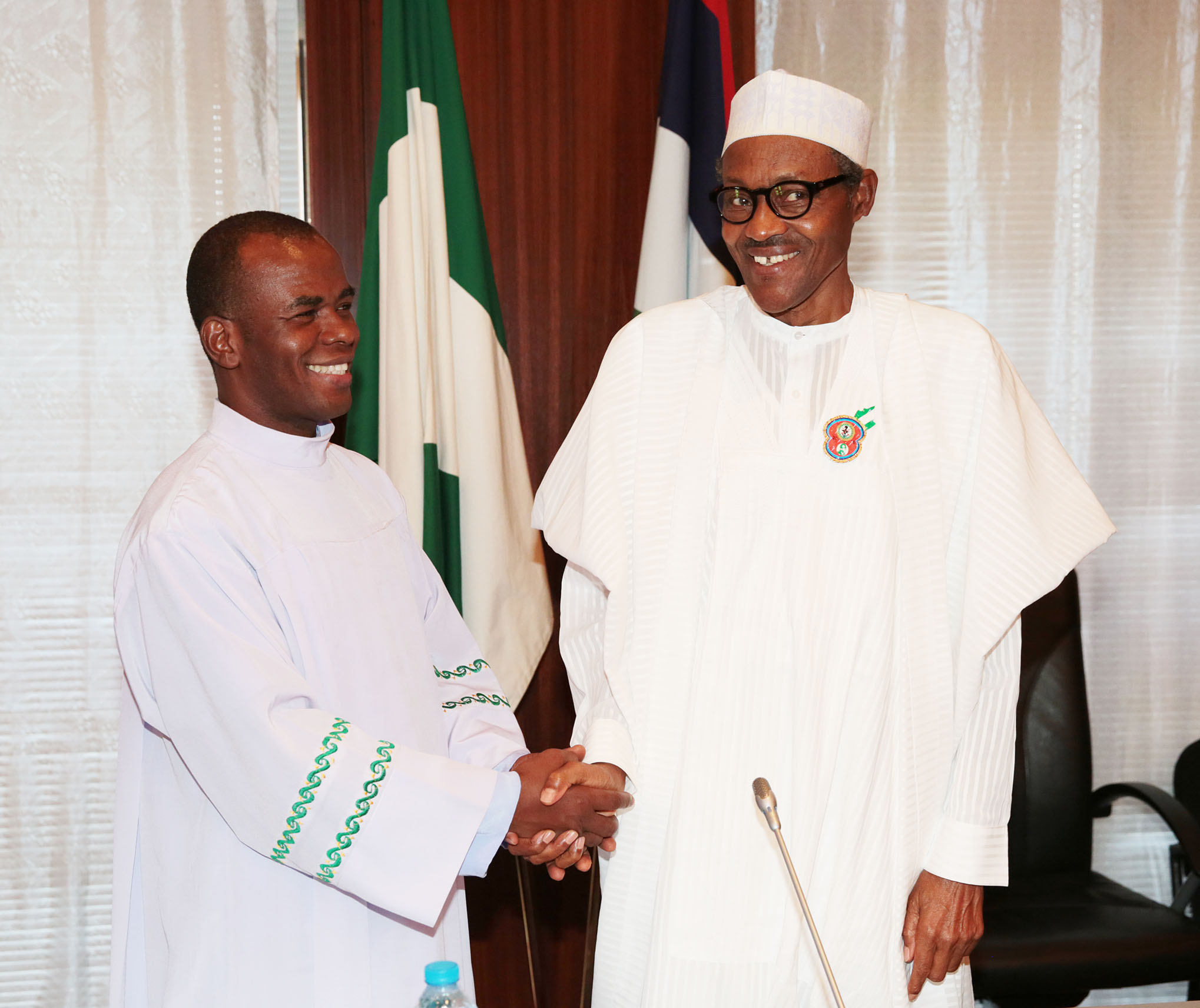 PRESIDENT BUHARI RECEIVES REV FR MBAKA. R-L; President Muhammadu Buhari and Rev Father Mbaka during an audience with President Buhari at the State House. DEC 18 2015.