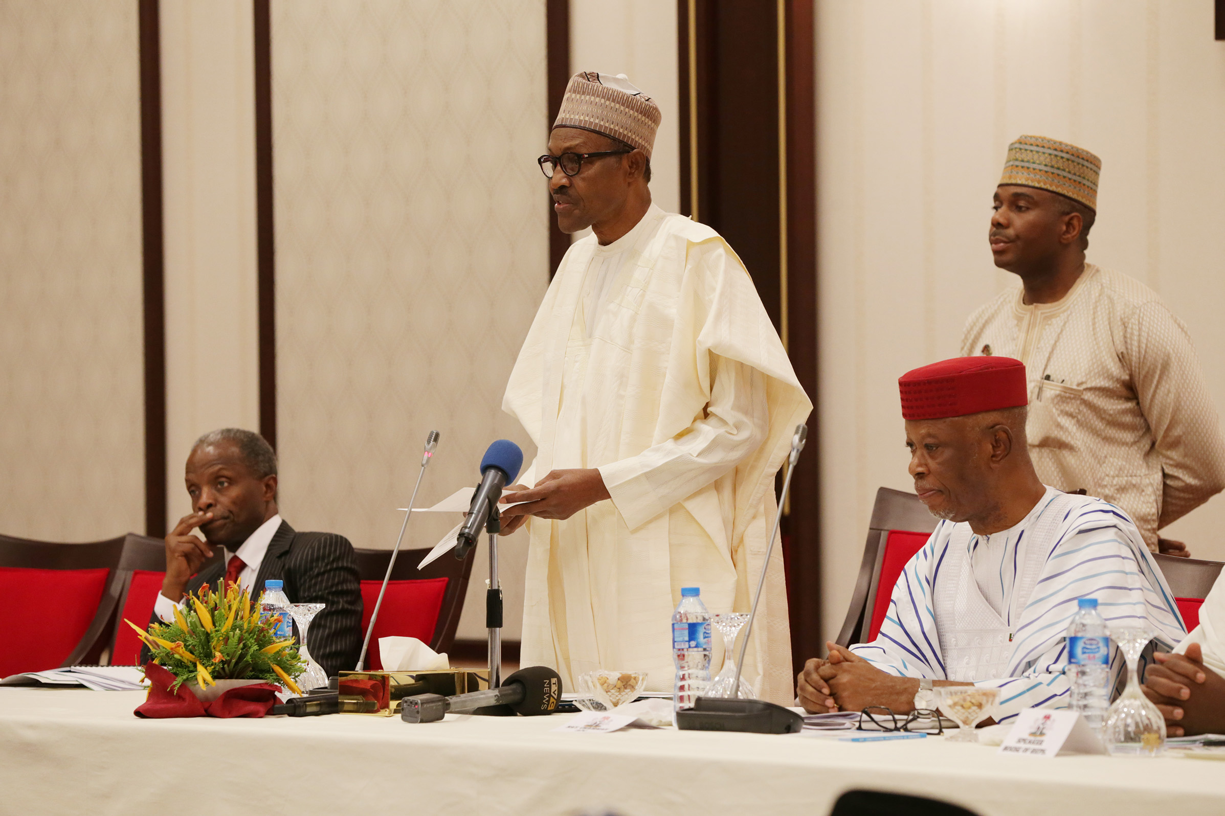 PRESIDENT BUHARI CHAIRS 4TH NAT APC CAUCUS MEETING. President Muhammadu Buhari (M) flanked by the Vice President Yemi Osinbajo and Naional Chairman Chef John Odigie Oyegun during the Party' 4th National Caucus Meeting held Monday night at the Presidential Villa Abuja. PHOTO; SUNDAY AGHAEZE. FEB 26 2018