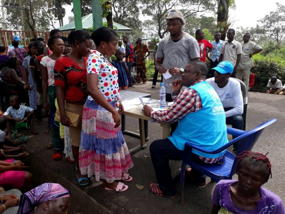 UNHCR staff and local authorities assist recently arrived Cameroonians seeking refuge in Obanliku, south-east Nigeria, October 2017.   © UNHCR/Jacob Pahar