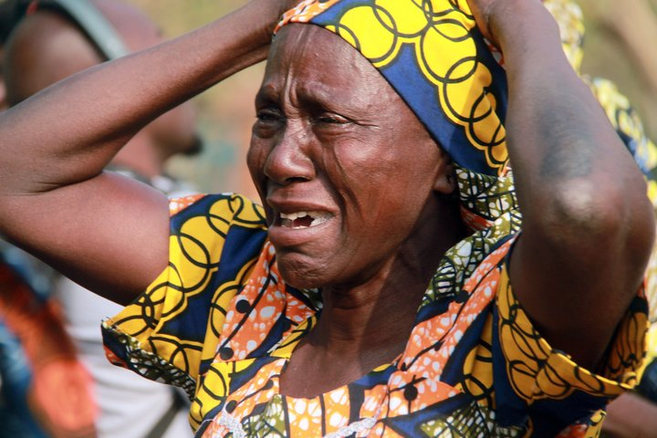 """A mother cries for her missing daughter abducted in 2014 by Boko Haram Islamists, during a march to press for the release of the schoolgirls kidnapped in 2014 from their school in Chibok by the Islamist group, in Abuja on January 14, 2016. Parents of the some 200 girls kidnapped by Boko Haram in April 2014, marched along with members of the civil society and the """"Bring Back Our Girls"""" movement, towards the presidency to press for speedy rescue of the schoolgirls, as Nigeria's government declared the Islamist group """"technically defeated"""". / AFP / STRINGER (Photo credit should read STRINGER/AFP/Getty Images)"""