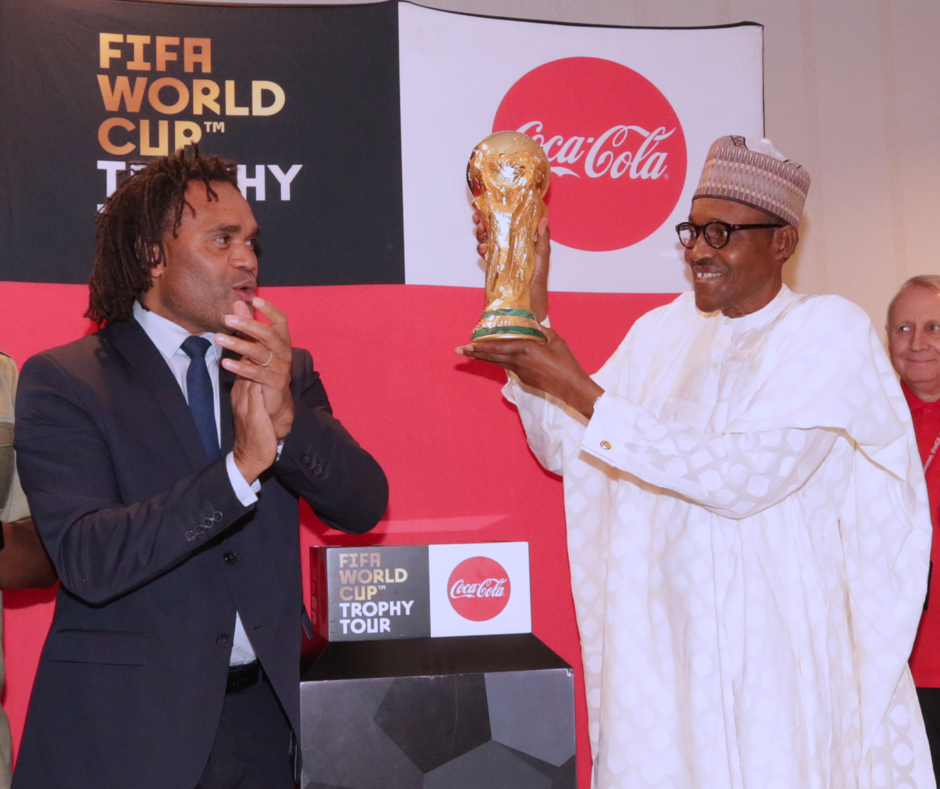 PRESIDENT BUHARI RECEIVES FIFA WORLD CUP TROPHY 1B. President Muhammadu Buhari with Fifa World Cup Trophy by Fifa Legend, Christian Karembeu ahead of the 2018 football World Cup during an audience with the President Buhari at the State House. PHOTO; SUNDAY AGHAEZE. MAR 7 2018.