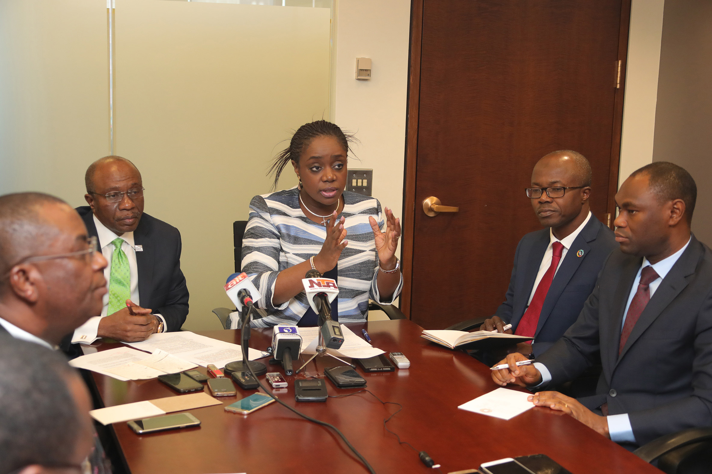CBN GOV AND FIN MIN BRIEF PRESS. 2.  The Central Bank Governor, Mr Godwin Emefiele, Minister of Finance Mr Kemi Adeosun and others during a press briefing a successful outing at the International Monetary Fund and World Bank Spring Meetings held in Washington DC, APRIL 22 2018.