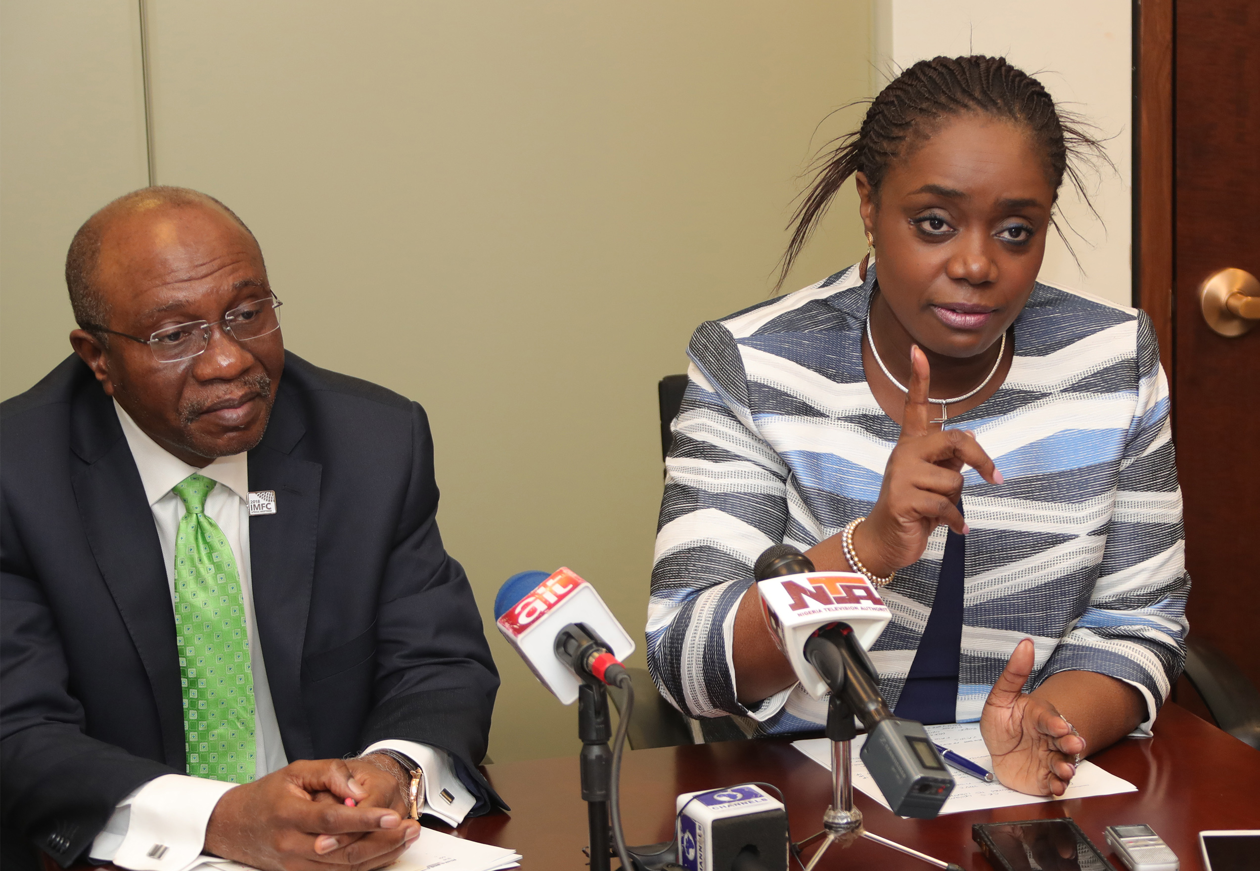 CBN GOV AND FIN MIN BRIEF PRESS. 3. L-R;  The Central Bank Governor, Mr Godwin Emefiele, Minister of Finance Mr Kemi Adeosun during a press briefing a successful outing at the International Monetary Fund and World Bank Spring Meetings held in Washington DC, APRIL 22 2018.