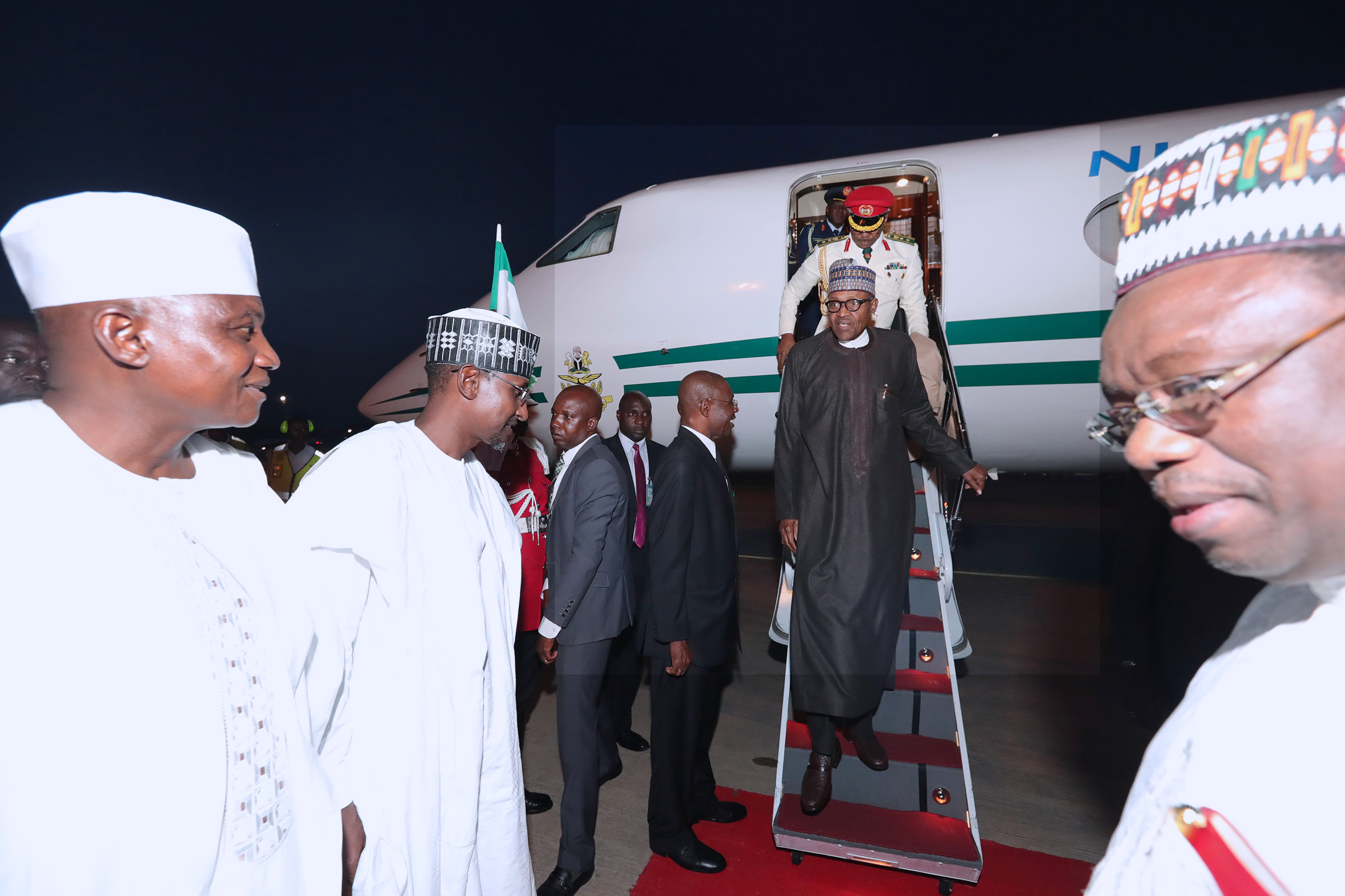 PRESIDENT BUHARI RETURNS FROM UK A. President Muhammadu Buhari returns Abuja from the United Kingdom. Waiting to receive him is the Minister of FCT Mallam Muhammad Musa Bello at the Presidential Wings of Nnamdi Azikiwe International Airport Abuja. PHOTO; SUNDAY AGHAEZE. MAY 11 2018
