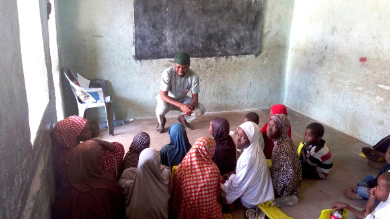 Philip Obaji Jr. in Maiduguri interviewing children displaced by the Boko Haram insurgency in northeast Nigeria about exploitation in the places they live and at school. Courtesy of Philip Obaji Jr.