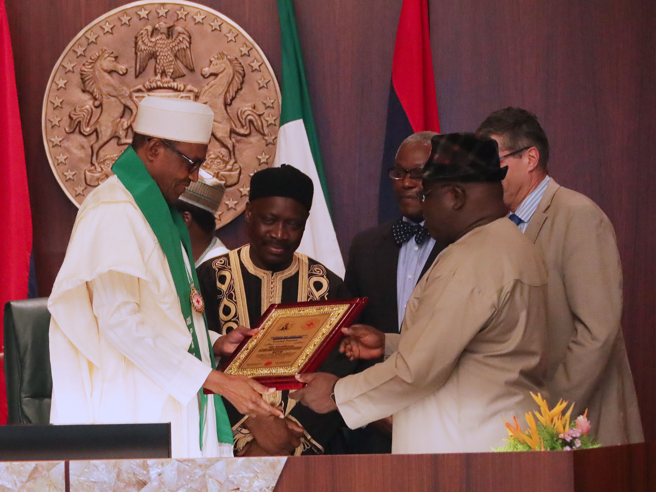 The Day in Pictures: President Buhari becomes Grand Patron of the Nigerian Red Cross