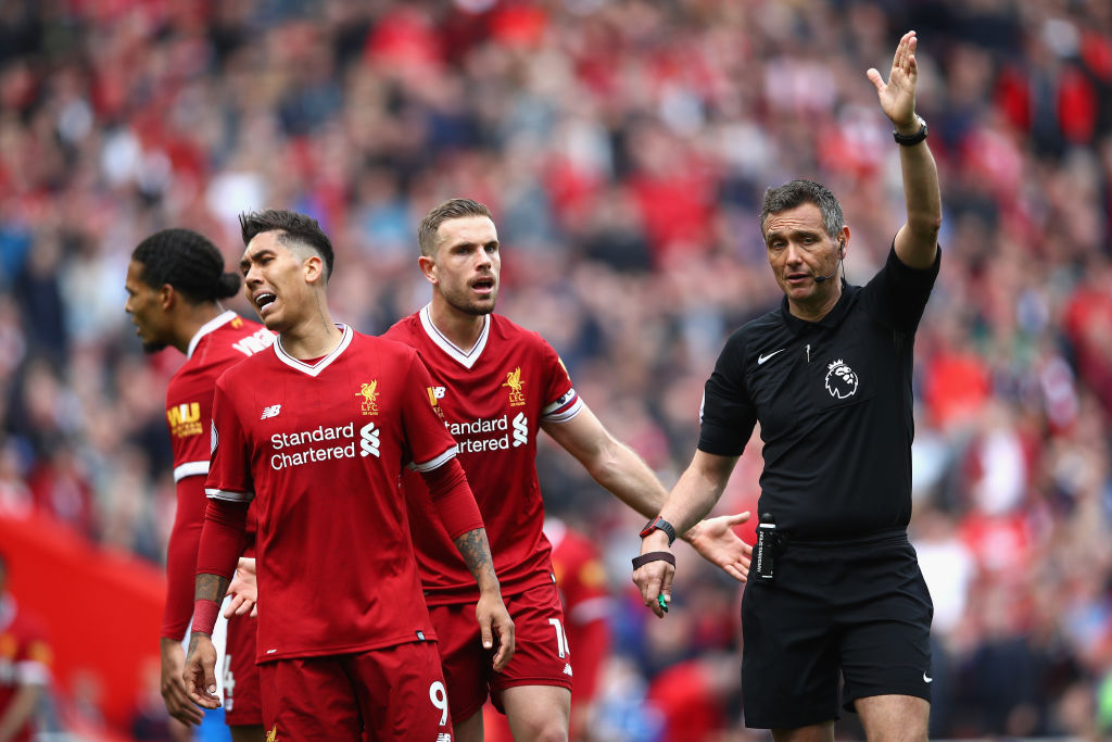 LIVERPOOL, ENGLAND - APRIL 28: Roberto Firmino of Liverpool reacts to a decision during the Premier League match between Liverpool and Stoke City at Anfield on April 28, 2018 in Liverpool, England. (Photo by Clive Brunskill/Getty Images)