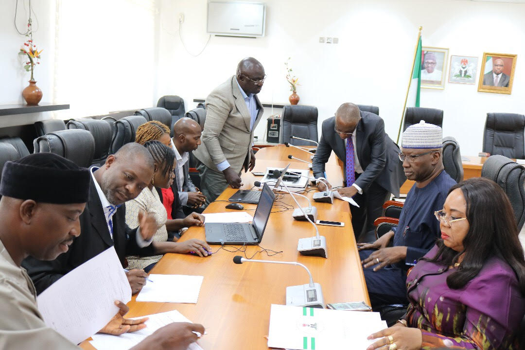 SGF, Boss Mustapha undergoing Screening before the verification team on Integrated Personnel and Payroll Information System (IPPIS) at Office of Secretary to the Government of the Federation. He is flanked on the right by Georgina Ehuriah, Permanent Secretary, Cabinet Affairs Office and left Olusegun  Adekule,Permanent Secretary General Services Office, Office of Secretary to the Government of the Federation