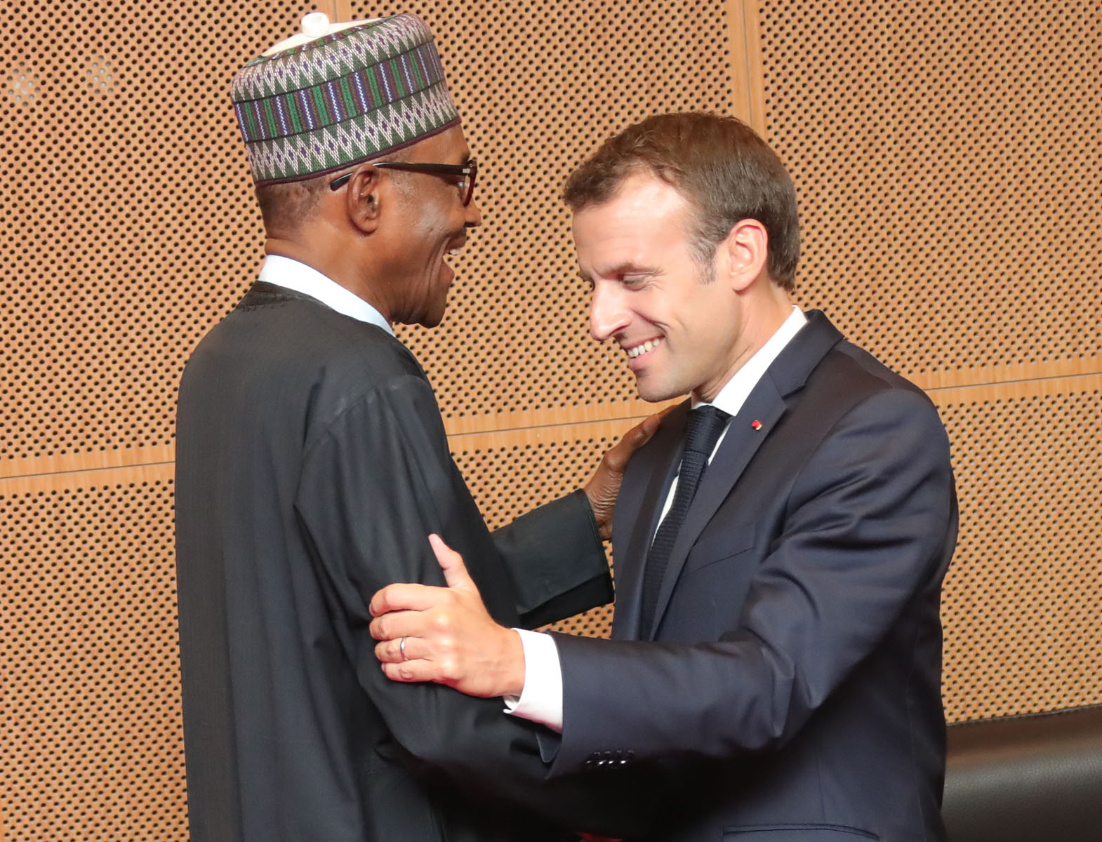Buhari shares a laugh with French president Macron at the AU Summit in Nouakchott