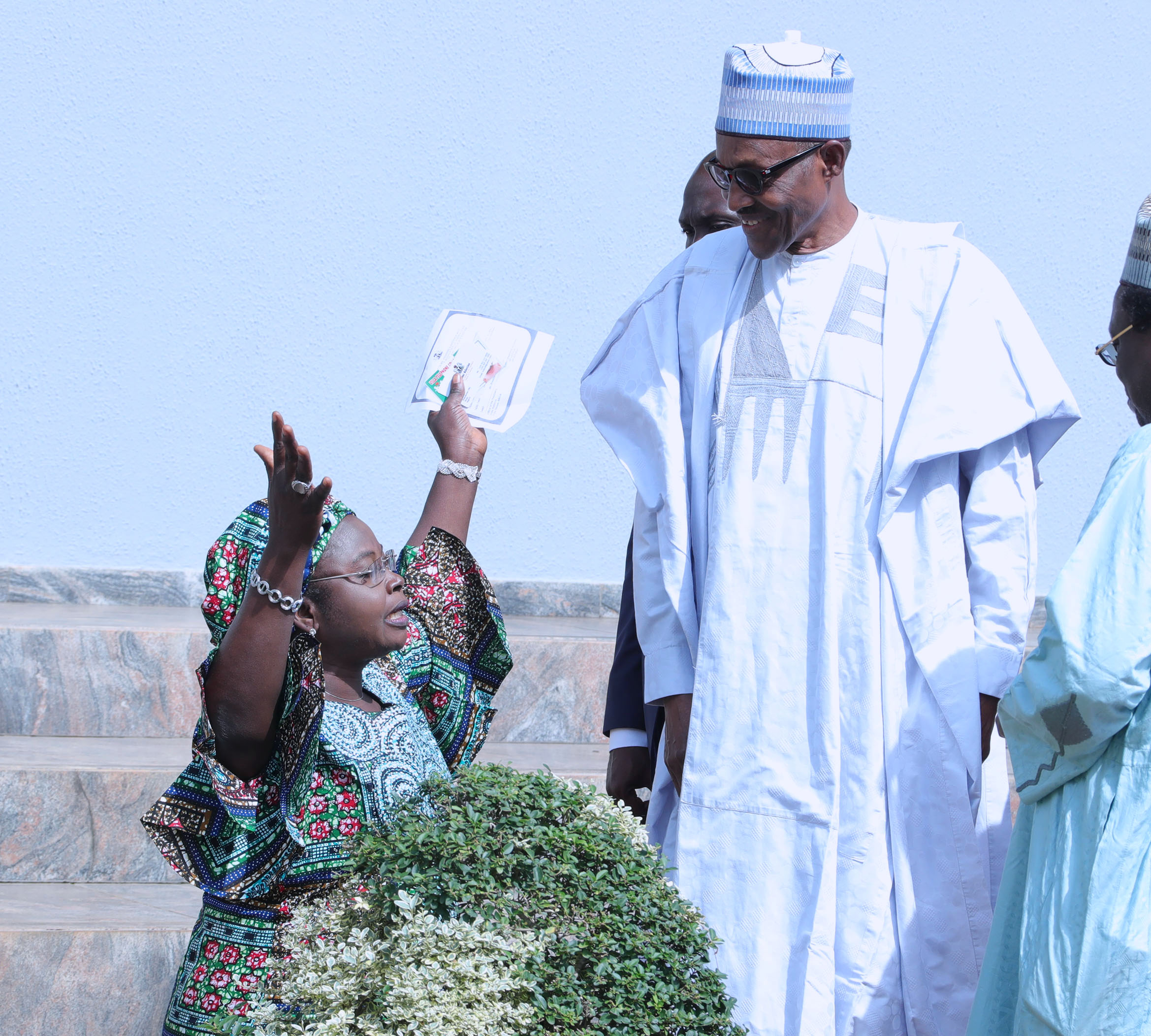 Herdsmen killings: Buhari shows empathy, as Christian woman in tears, kneels, pleads for audience with President