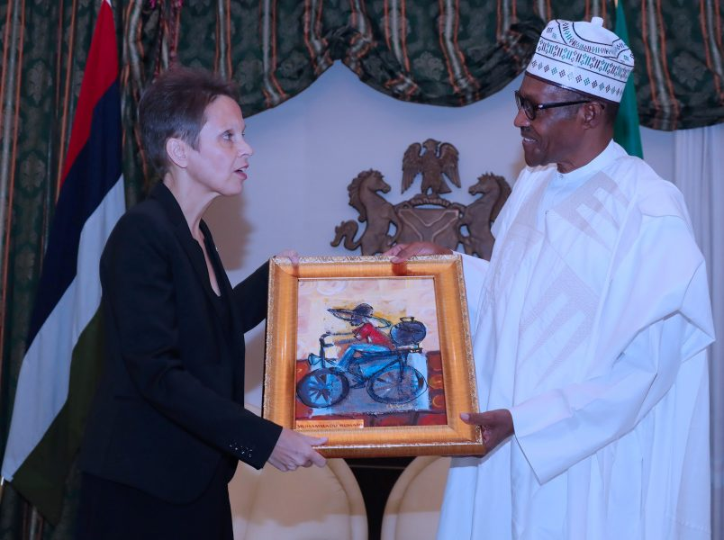 PRESIDENT BUHARI RECEIVES OUTGOING FINLAND AMB. 4. President Muhammadu Buhari presents a parting gift to the outgoing Finland Ambassador to Nigeria, H.E.Pirjo Suomela-Chowdhury during a farewell audience Friday at the State House in Abuja. PHOTO; SUNDAY AGHAEZE. JULY 27 2018.