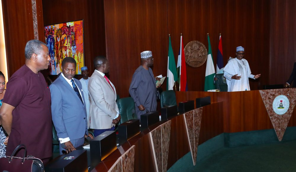 PRESIDENT BUHARI SIGNS EXECUTIVE ORDER 6. PIC 4. R-L;President Muhammadu Buhari, SGF Mr Boss Mustapha,NSA Majo General Babagana Munguno, Minister of Justice and Attorney General of the Federation, Abubakar Malami and Minister of Foreign Affairs, Mr. Geoffrey Onyeama during the signing of Executive Order 6 on the Preservation of Suspicious Assets Connected with Corruption held at the Council Chambers State House, Abuja. PHOTO; SUNDAY AGHAEZE. JULY 5 2018.