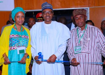PRESIDENT BUHARI DECLARES OPEN 2018 AFRICAN PORTS AND HINTERLAND REGIONAL CONFERENCE 1; R;  President Muhammadu Buhari (M) flanked by Minister of Transportation, Mr. Rotimi Ameachi and Nigerian Ports Authority, Managing Director, Ms. Hadiza Balab Usman during the cutting of the tape to declare open 2018 African Ports and Hinterland connectivity Regional Conference held at the Transcorp Hilton Hotel Abuja. PHOTO; SUNDAY AGHAEZE. SEPT 17 2018.