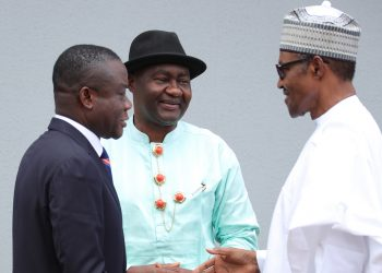 PRESIDENT BUHARI RECEIVES OGONI LEADERS 1B; President Muhammadu Buhari Chats with Senator Mangus Abe and Executive Director NDDC, Mene Edfa during a courtesy visit by delegation of Surpreme Council of Traditional Rulers of Ogoni Kindom at the State House in Abuja. PHOTO; SUNDAY AGHAEZE. SEPT 14 2018