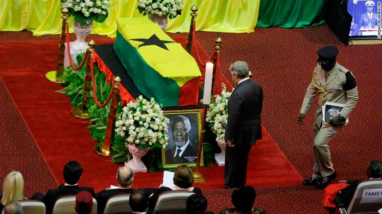 Current U.N. Secretary-General Antonio Guterres, center, pays his respects by the coffin of former U.N. Secretary-General Kofi Annan, draped with the Ghana flag, during a state funeral at the Accra International Conference Center in Ghana Thursday, Sept. 13, 2018. After days of lying in state for mourners to pay their respects the body of Kofi Annan, who died in August in Switzerland at age 80, will be buried Thursday after a final funeral ceremony. (AP Photo/Sunday Alamba)