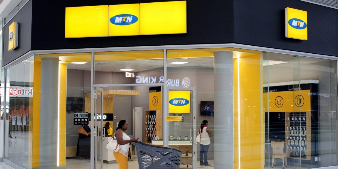 A shopper walks past an MTN shop at a mall in Johannesburg, South Africa, March 2, 2017. REUTERS/Siphiwe Sibeko