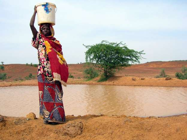 woman fetching water for consumption in Northeast