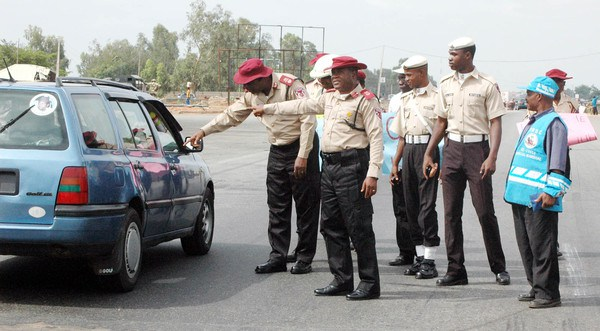 """PIC. 12.  FRSC ZONAL COMMANDER,  ASSISTANT CORPS MARSHAL, CHARLES THEOPHILUS (L), WITH SECTOR   COMMANDER, CORPS COMMANDER OLUMIDE OLAGUNJU, AT THE COMMENCEMENT FRSC """"OPERATION SHIELD"""" ON    KADUNA - ABUJA HIGH WAY IN KADUNA ON MONDAY (6/5/13) ."""