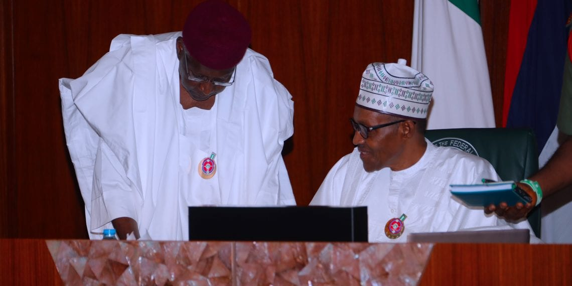 PRESIDENT BUHARI PRESIDES OVER SPECIAL FEC MEETING 0A. President Muhammadu Buhari confers with the Chief of Staff Mallam Abba Kyari during a special FEC Meeting held at the Council Chambers State House Abuja. PHOTO; SUNDAY AGHAEZE. DEC 7 2018