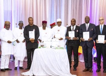 PRESIDENT BUHARI DECLARES OPEN WORKSHOP ON CORRUPTION RISK ASSESSMENT 6A&B. BOOK PRESENTATION: President Muhammadu Buhari (M) flanked by Chief of Staff, Mallam Abba Kyari (left) and ICPC Acting Chairman, Dr Musa Usman Abubakar (right). With them are SGF Mr Boss Mustapha, Minister of Foreign Affairs, Mr Geoffrey Onyeama, FCT Minister Mallam Mohammed Musa Bello and others during the opening ceremony of the training workshop on corruption risk assessment for the heads of anti-corruption agencies in Africa held at the banquet hall. State House Abuja. PHOTO; SUNDAY AGHAEZE. DEC 10 2018