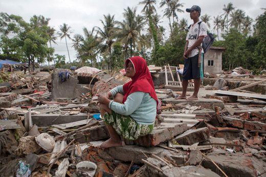 An Indonesian tsunami victim sits on the ruins of her house after a tsunami hit the Sunda Strait, in Paniis Village, Pandeglang, Banten, Indonesia on Dec. 25, 2018. Zulkifli, EPA-EF