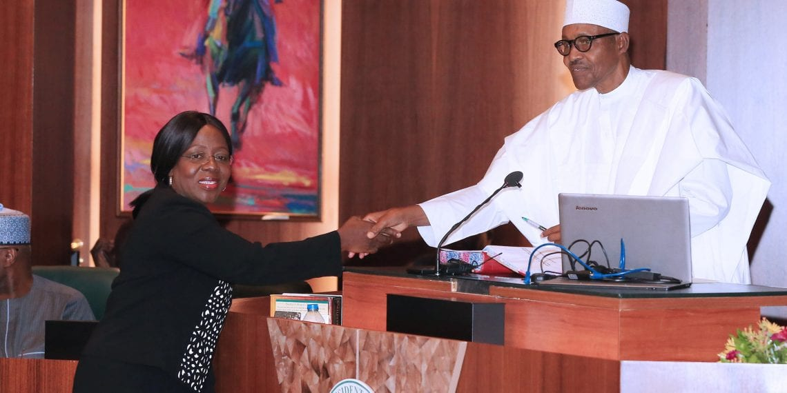 PRESIDENT BUHARI SWEARS -IN- NEW PERM SEC 1A. Dr Magdalene Nwanwuche Ajani during her swearing-in by President Muhammadu Buhari at the Council Chamber, State House Abuja. PHOTO; SUNDAY AGHAEZE. FEB 20 2019