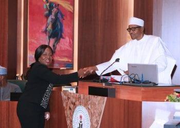 PRESIDENT BUHARI SWEARS -IN- NEW PERM SEC 1A. Dr Magdalene Nwanwuche Ajani during her swearing-in by President Muhammadu Buhari at the Council Chamber, State House Abuja. PHOTO; SUNDAY AGHAEZE. FEB 20 2019