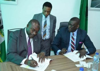 Deputy Managing Director, Fidelity Bank Plc, Mohammed Balarabe (L) and Senior Director, African Development Bank (AfDB), Ebrima Faal (R), during the formal signing ceremony of $50M line credit between Fidelity Bank Plc and African Development Bank (AfDB) in Abuja, recently.