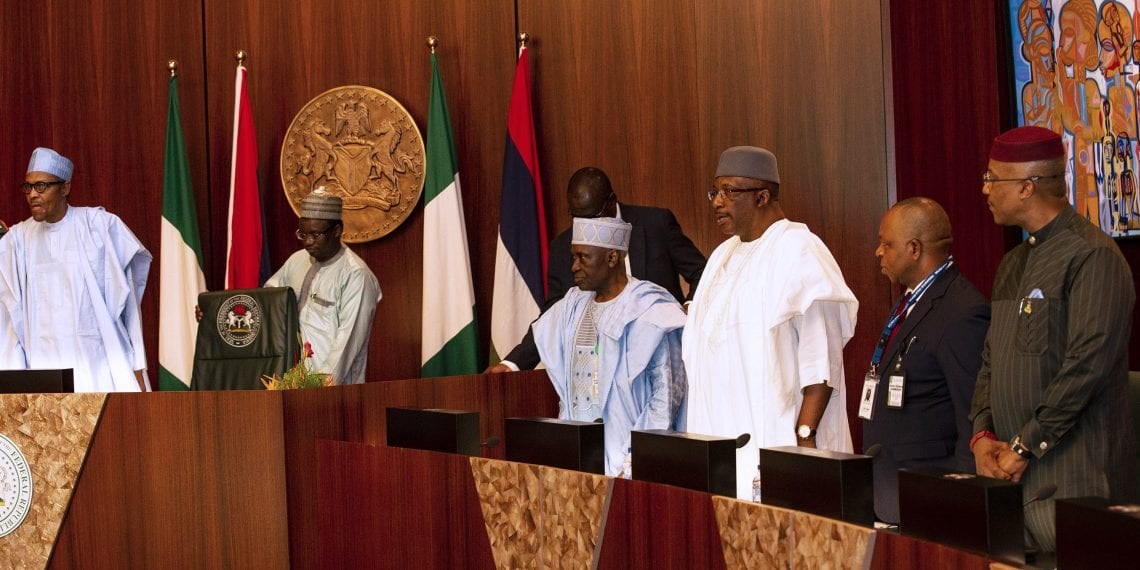 PRESIDENT BUHARI AND POLICE COUNCIL CONFIRM IG OF POLICE 2A&B. L-R; President Muhammadu Buhari, chairman of the Police Service Commission (PSC), Musiliu Smith, Minister of Interior, Lt Gen Abdulrahman Dambazzau and Anambra Deputy Governor, Mr Nkem Okeke during the confirmation of Inspector of Police, Alhaji Adamu Muhammed by the Police Council held at the State House Thursday in Abuja. PHOTO; SUNDAY AGHAEZE. MAY 23 2019