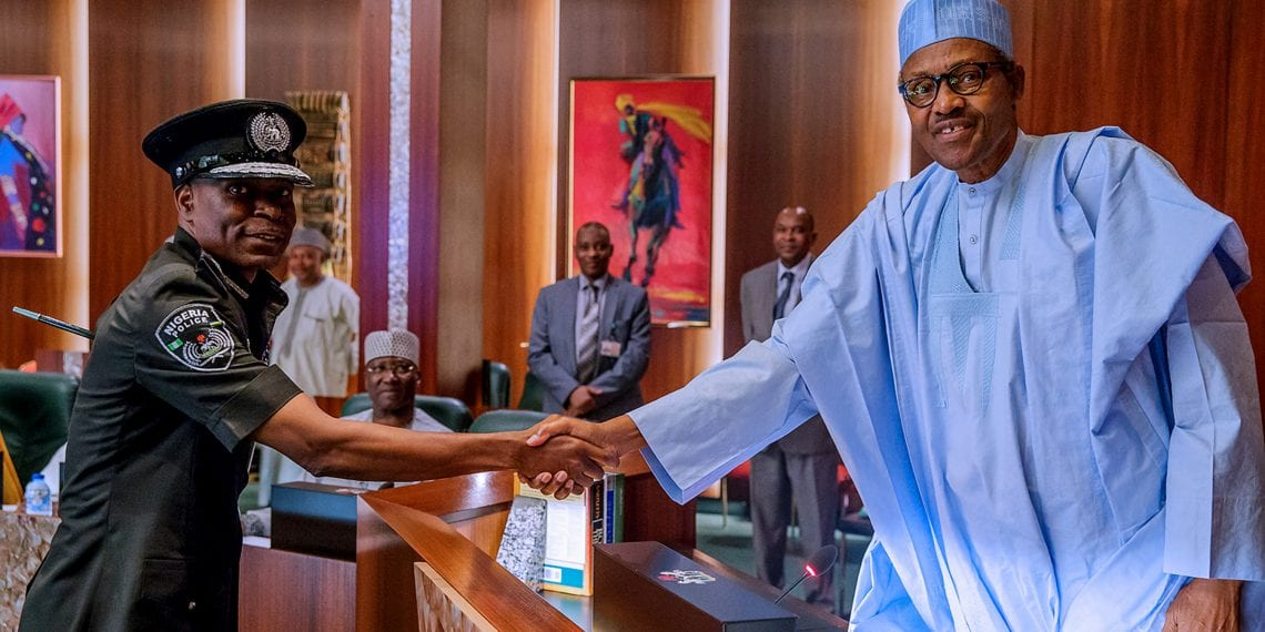 PRESIDENT BUHARI AND Police Council AB. President Muhammadu Buhari in a handshake with the Inspector of Police, Mr Mohammad Adamu during the confirmation by the Police Council at the State House Abuja. PHOTO; SUNDAY AGHAEZE MAY 23 2019