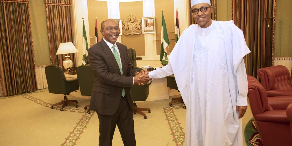 PRESIDENT BUHARI CONGRATULATES THE CBN GOVERNOR, EMEFIELE 1-2B. President Muhammadu Buhari receives and congratulate the Central Bank Governor of Nigeria, Mr Godwin Emefiele in his office State House Abuja. PHOTO; SUNDAY AGHAEZE. MAY 13 2019