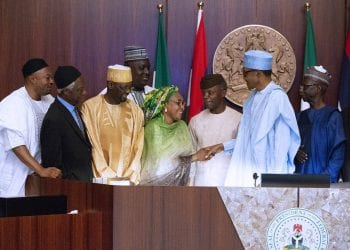PRESIDENT BUHARI INAUGURATES NORTH-EAST DEV COMM 2B. FROM RIGHT 2A&B. Chairman of the Commission, Maj General Paul Tarfa (Rtd), President Muhammadu Buhari in a handshake with North West Zone representatives, Hajiya As'mau Mai-Eka Mohammed. Others are Vice President Yemi Osinbajo, MD/CEO Mohammed Goni Alkali, ED Humanitarian Affairs, Alh Musa Umar Yashi, ED Admin and Finance, Alh Muhammed Jawa Gashu'a, Hon David Sabo Kente, , Hon Benjamin Tilly Adanyi, Hon Olawale Oshun, Dr Ikechukwu Theodore Okwu Ejike and Mr. Obasuke Mcdonald duringtheir swearing-in by the President as members of North-East Development Commission at the Council Chamber, State House Abuja. PHOTO; SUNDAY AGHAEZE. MAY 8 2019