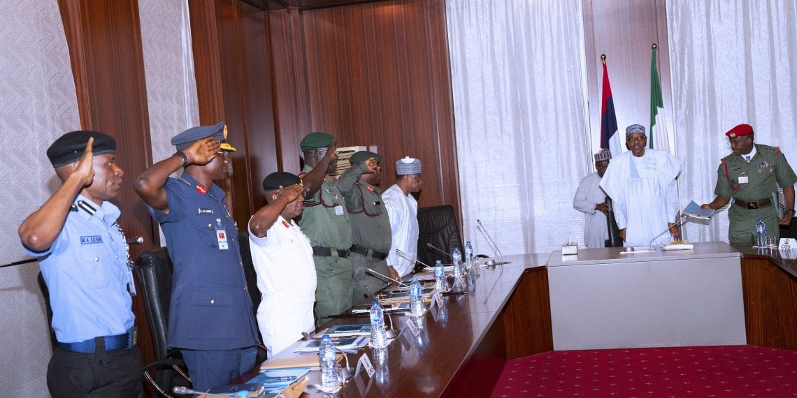 PRESIDENT BUHARI PRESIDES OVER SECURITY MEETING 1A&B. R-L; President Muhammadu Buhari, Minister of Defence, Brig Gen Mansur Dan Ali, Chief of Defence Staff, General Abayomi Olonisakin, Chief of Army Staff, Lt Gen T.Y Buratai, Chief of Naval Staff Vice Admiral Ibok Ekwe Ibas, Representatives of Chief of Air Staff, Chief of Training and Operations (CTOPS), Air Vice Marshal EO Anebi and Acting Inspector General of Police,  Mohammed Abubakar Adamu during a Security Meeting at the State House Abuja. PHOTO; SUNDAY AGHAEZE. MAY 9 2019.