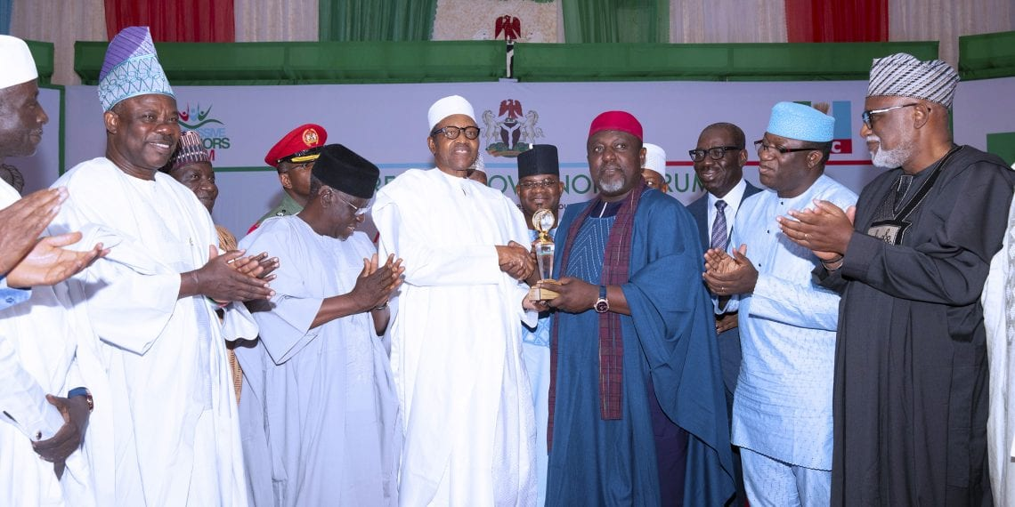 PRESIDENT BUHARI RECEIVES PROGRESSIVES GOVERNORS AWARD 1B. President Muhammadu Buhari receives the honours award from the Chairman Progressive Governor's Forum and Imo State governor, Owelle Rochas Okorocha. Others are Governors of Kogi State Yahaya Bello, Ekiti State Dr Kayode Fayemi, Ondo State Mr. Rotimi Akeredolu, Niger State, Alhaji Abubakar Sani Bello, Nassarawa State Governor, Alhaji Tanko Almakura, Plateau State Simon Lalong, Ogun State Governor, Sen Ibikunle Amosun during the Presentation by the APC Progressive Governor Forum held at the Presidential Banquet Hall, State House Abuja. PHOTO; SUNDAY AGHAEZE. MAY 10 2019.