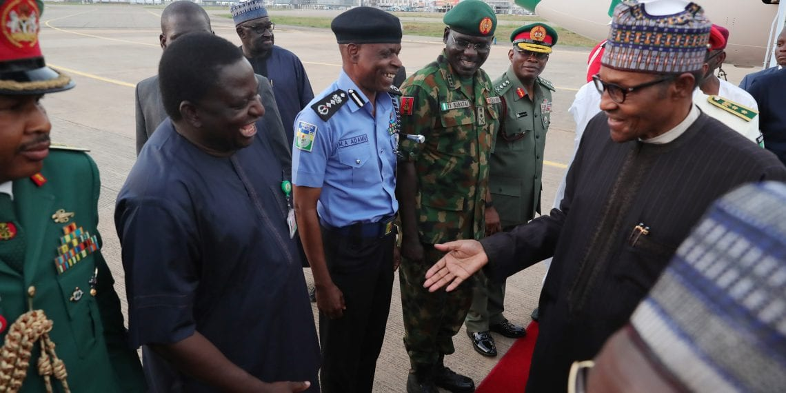PRESIDENT BUHARI RETURNED  7. President Muhammadu Buhari Chats with SA Media Mr Femi Adesina. Others Chief of Army Staff, Lt Gen T.Y Buratai. Others are Chief of Defence Staff General Abayomi Olonisakin, FCT Minister Mallam Muhammed Musa Bello and Inspector General of Police, Mr Adamu as president return from the UK after 10 days vacation. PHOTO; SUNDAY AGHAEZE. MAY 5 2019