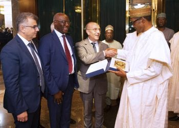 PRESIDENT BUHARI IN AUDIENCE FROM ITALIAN PARLIAMENT 2A&B. R-L; President Muhammadu Buhari receives a present from Mr. Giovanni Baocchi, Italian Parliamentary Sen T.C Iwobi, Italian Parliamentary, Sen Manuel Vescovi during an audience with the Delegation held at the State House in Abuja. PHOTO; SUNDAY AGHAEZE. JUNE 10 2019