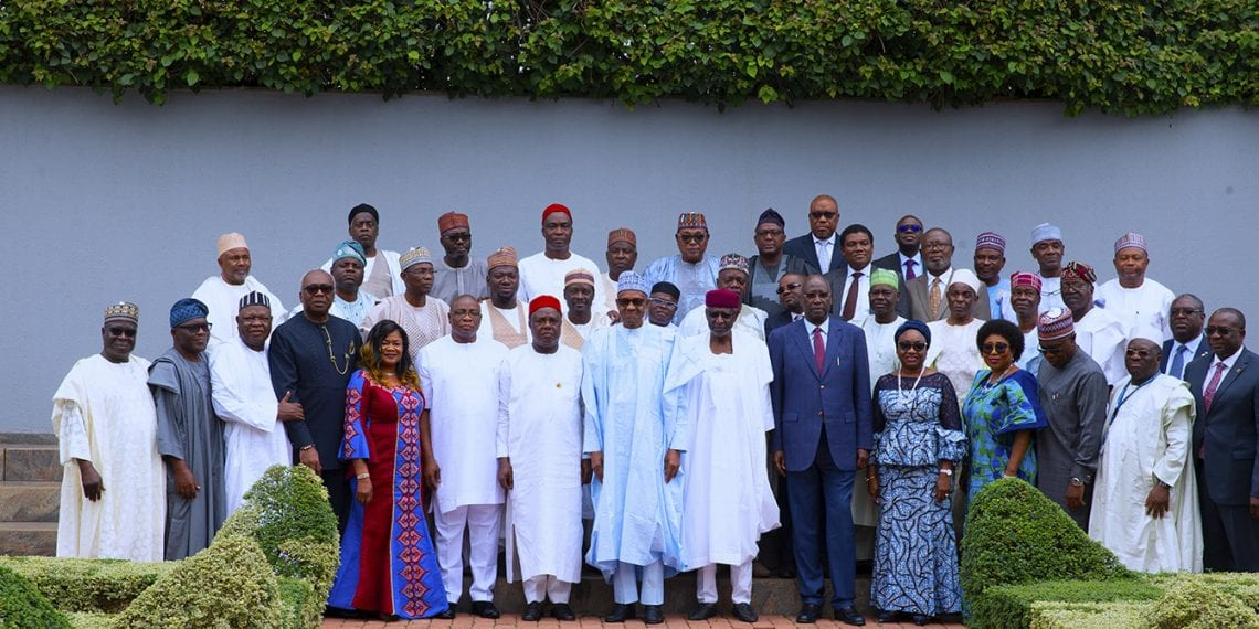 PRESIDENT BUHARI SWEAR-IN RMAFC MEMBERS 1. President Muhammadu Buhari (M) flanked by Chairman of the Revenue Mobilisation Allocation and Fiscal Commission, Engr Elias Mbam, Chief of Staff, Mallam Abba Kyari and others during the swearing-in of Chairman and Commissioner of the Commission held at the State House, Abuja. PHOTO; SUNDAY AGHAEZE. JUNE 27 2019