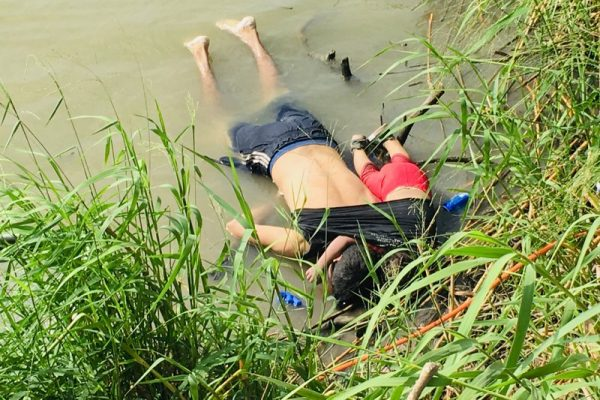 The bodies of Salvadoran migrant Oscar Alberto Martínez Ramírez and his nearly 2-year-old daughter Valeria lie on the bank of the Rio Grande in Matamoros, Mexico, Monday, June 24, 2019, after they drowned trying to cross the river to Brownsville, Texas. Martinez' wife, Tania told Mexican authorities she watched her husband and child disappear in the strong current. (AP Photo/Julia Le Duc)